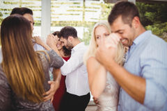 Group of young friends dancing. At the party stock photos