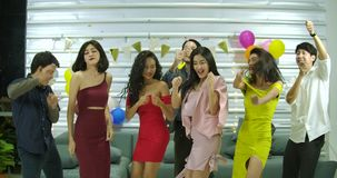 Group of young friends dancing together at a party, People with party, celebration, enjoyment and new year concept. Slow Motion