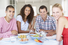 Group Of Young Friends Eating Meal At Home Royalty Free Stock Images