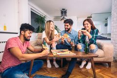Group of young friends eating pizza Stock Photo