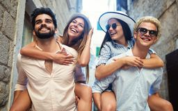 Group of young friends hangout on city street stock photo