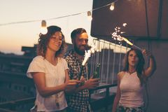 Friends at a rooftop party royalty free stock images
