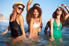 Group Of Young Friends Having Fun In Sea Together Royalty Free Stock Photo
