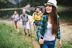 Group of young friends hiking in countryside. Multiracial happy people travelling in nature. Group of young friends hiking in countryside. Multiracial happy stock photography