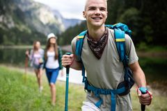 Group of young friends hiking in countryside. Multiracial happy people travelling in nature. Group of young friends hiking in countryside. Multiracial happy royalty free stock photo