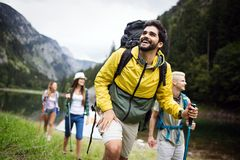 Group of young friends hiking in countryside. Multiracial happy people travelling in nature. Group of young friends hiking in countryside. Multiracial happy royalty free stock image