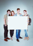Group of young friends holding a blank board,  on white background Stock Photo