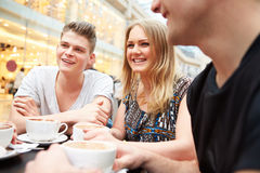 Group Of Young Friends Meeting In Cafe Stock Photography