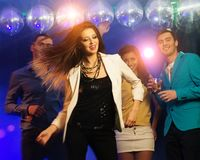Group of young friends  at night club Royalty Free Stock Image