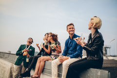 Group of young friends partying on terrace stock photo