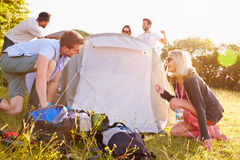 Group Of Young Friends Pitching Tents On Camping Holiday Stock Photography