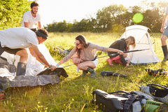 Group Of Young Friends Pitching Tents On Camping Holiday Stock Photos