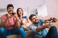 Group of young friends play video games together. At home Royalty Free Stock Photography