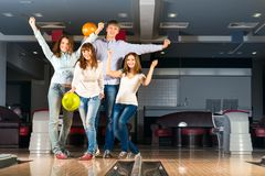 Group of young friends playing bowling Royalty Free Stock Photography