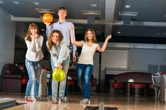 Group of young friends playing bowling Royalty Free Stock Photo