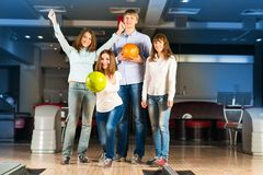 Group of young friends playing bowling Royalty Free Stock Image