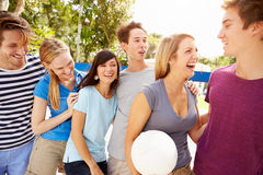 Group Of Young Friends Playing Volleyball Match Royalty Free Stock Image