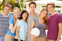 Group Of Young Friends Playing Volleyball Match Royalty Free Stock Photos