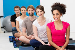 Group of young friends practising yoga Stock Image