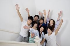 Group of young friends raising arms Stock Photography