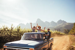 Group of young friends riding in pickup truck Stock Photo