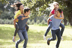Group Of Young Friends Running Through Countryside Royalty Free Stock Photo