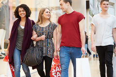 Group Of Young Friends Shopping In Mall Together Stock Photos