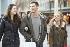 Group Of Young Friends Shopping Outdoors Together Royalty Free Stock Images