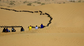 Group of young friends sitting together in a desert in Dubai, UAE Stock Image