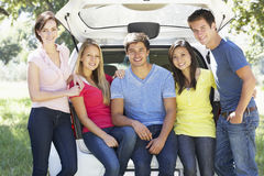 Group Of Young Friends Sitting In Trunk Of Car Stock Photos