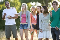 A group of young friends standing in a field Stock Photos
