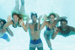 Group of young friends underwater Royalty Free Stock Photo