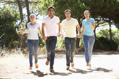 Group Of Young Friends On Walk In Countryside Stock Image