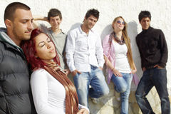 Group of young friends at the wall Stock Images