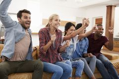Group Of Young Friends Watching Sports On Television And Cheerin Royalty Free Stock Images