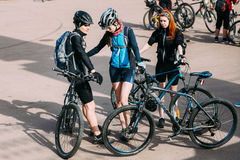 Group of young girls bicyclists at opening of the cycling season Royalty Free Stock Photography