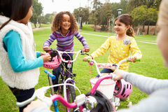 Group Of Young Girls With Bikes In Park Stock Photos
