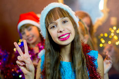 Group of young girls celebrating Christmas. First plan. Group of cheerful young girls celebrating Christmas near the Christmas tree with lights. Disco. First Royalty Free Stock Photos