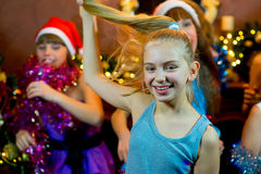 Group of young girls celebrating Christmas. First plan Royalty Free Stock Photography