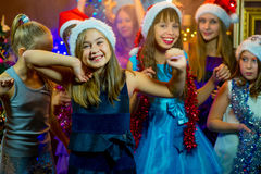 Group of young girls celebrating Christmas. First plan Royalty Free Stock Images