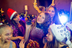 Group of young girls celebrating Christmas. First plan Stock Photo