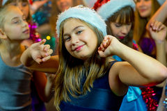 Group of young girls celebrating Christmas. First plan Stock Photography