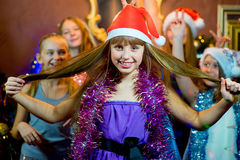 Group of young girls celebrating Christmas. First plan Royalty Free Stock Photo