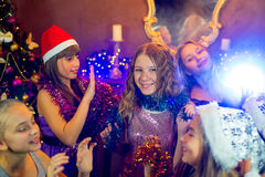 Group of young girls celebrating Christmas. First plan Stock Image