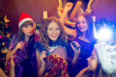 Group of young girls celebrating Christmas. First plan Stock Images