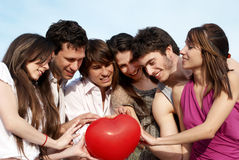Group of young guys and girls Royalty Free Stock Photos