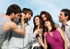 Group of young guys and girls in park Royalty Free Stock Images