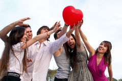 Group of young guys and girls in park Stock Images