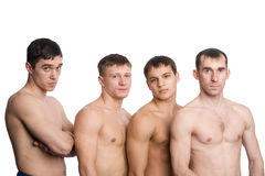 Group of young guys with muscular bodies Stock Photos