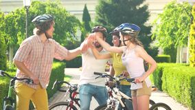 Group of young happy cyclists resting in park. stock footage